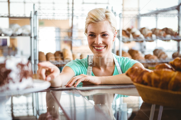 Smiling waitress posing next basket of bread Stock photo © wavebreak_media