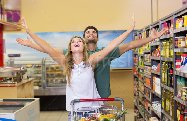 Happy bright couple buying food products  Stock photo © wavebreak_media