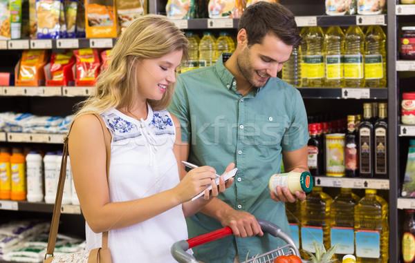 笑みを浮かべて 明るい カップル 買い 食品 製品 ストックフォト © wavebreak_media
