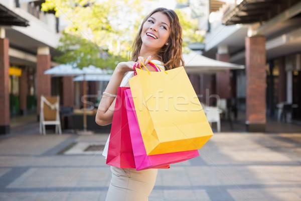 笑顔の女性 ショッピングバッグ ショッピング 女性 笑みを浮かべて ストックフォト © wavebreak_media