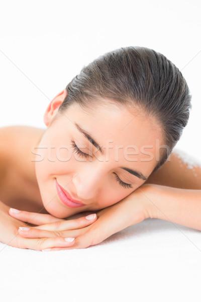 Beautiful brunette sleeping after a salt scrub treatment Stock photo © wavebreak_media