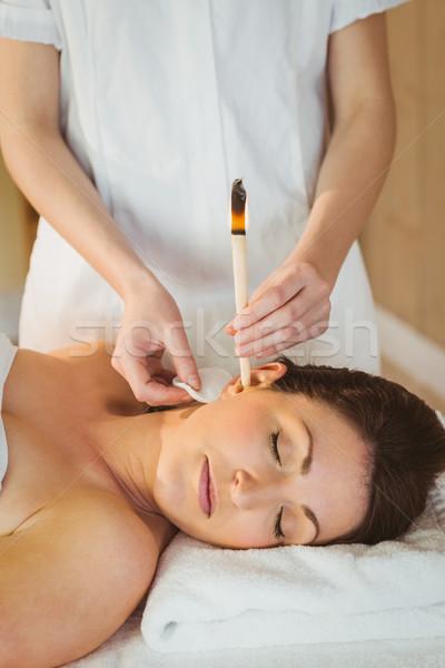 Young woman getting an ear candling treatment Stock photo © wavebreak_media
