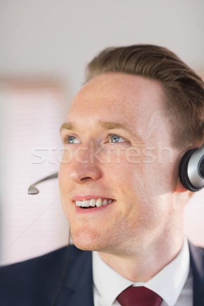 Happy call center agent working  Stock photo © wavebreak_media