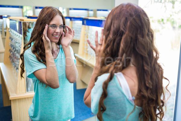 Woman shopping for new glasses Stock photo © wavebreak_media
