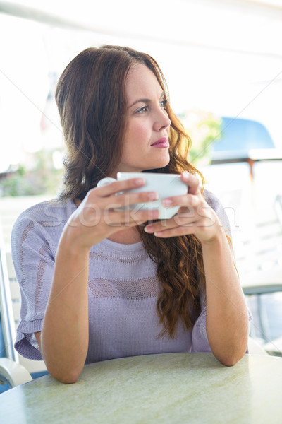 Joli brunette cappuccino café Photo stock © wavebreak_media