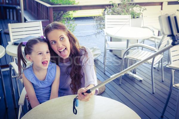 Mère fille bâton café terrasse Photo stock © wavebreak_media