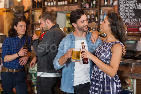 Amigos cerveja vidro garrafa contrariar Foto stock © wavebreak_media