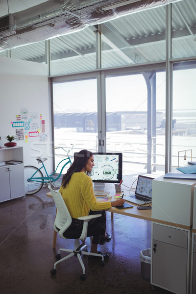 Confident female designer using digitizer on desk in office Stock photo © wavebreak_media