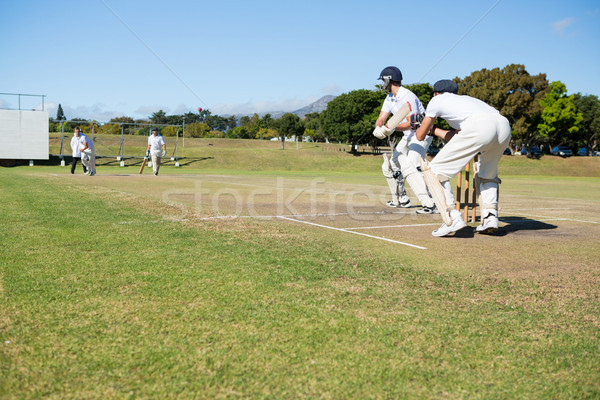 Cricket players playing match at field Stock photo © wavebreak_media