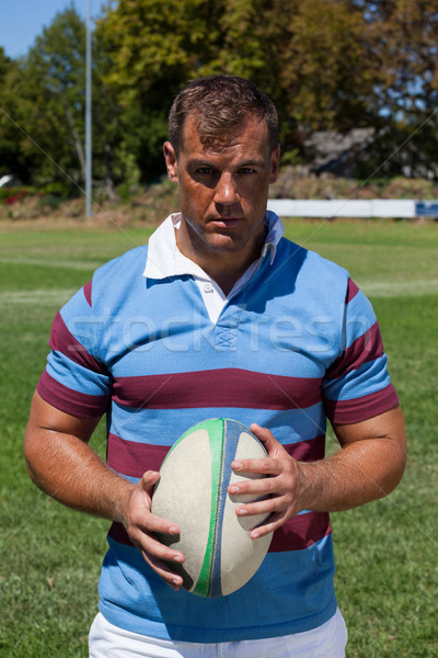 Portrait of confident rugby player with ball Stock photo © wavebreak_media