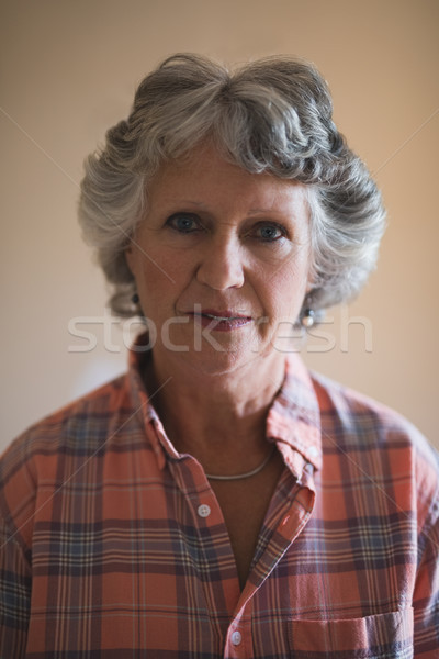 Portrait of senior woman against wall at home Stock photo © wavebreak_media