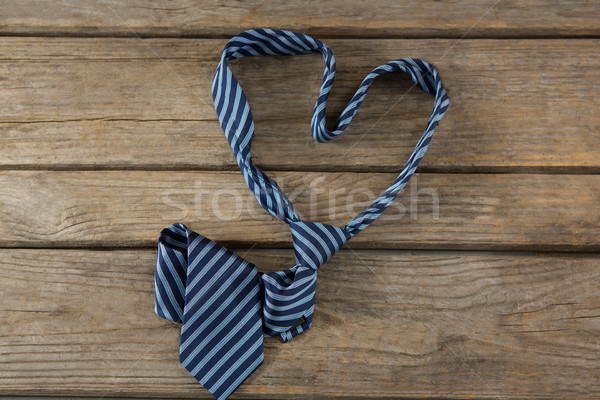 Overhead view of necktie in heart shape on table Stock photo © wavebreak_media