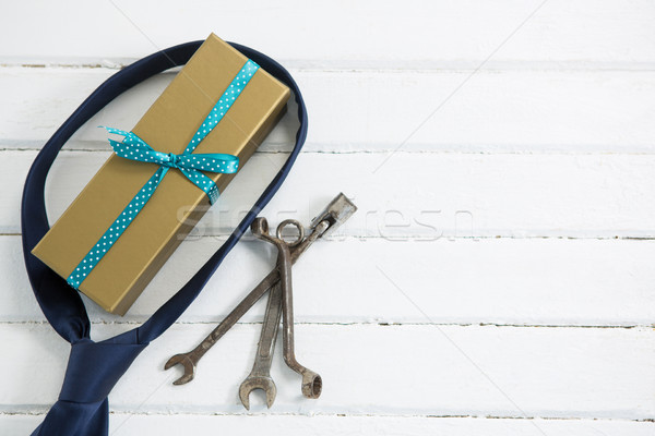 Overhead view of gift box with necktie and hand tools Stock photo © wavebreak_media