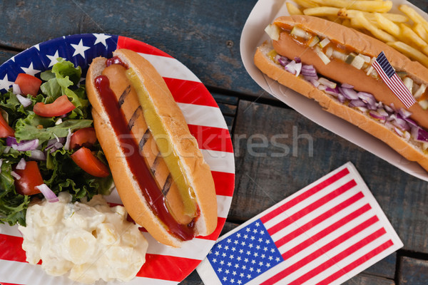 Hot dog and American flag on wooden table Stock photo © wavebreak_media