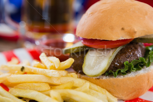Burger and french fries on wooden table with 4th july theme Stock photo © wavebreak_media