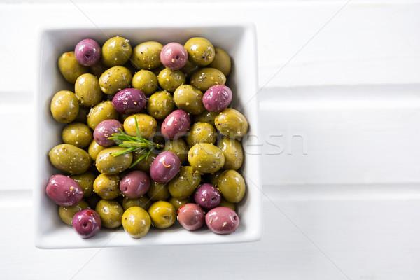 Marinált olajbogyók tál fa asztal étel gyümölcs Stock fotó © wavebreak_media