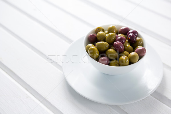 Mariné olives blanche bol table en bois alimentaire Photo stock © wavebreak_media