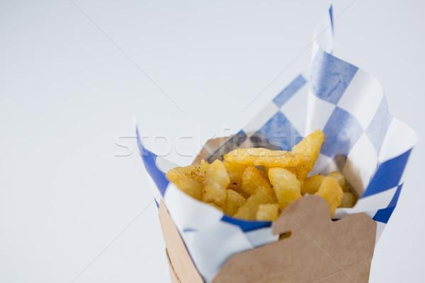 Közelkép sültkrumpli karton doboz asztal papír Stock fotó © wavebreak_media