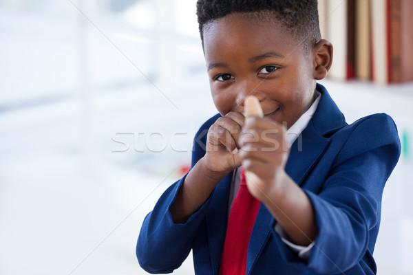 Portret jongen zakenman spelen elastiekje permanente Stockfoto © wavebreak_media