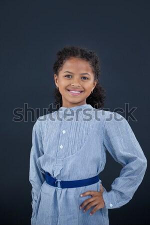 Portrait of smiling girl with hand on hip Stock photo © wavebreak_media