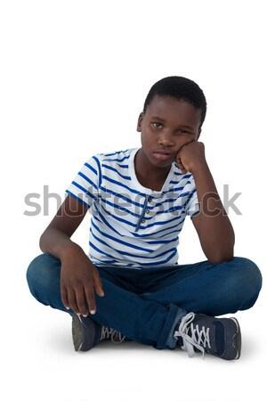 Sad boy sitting on floor Stock photo © wavebreak_media
