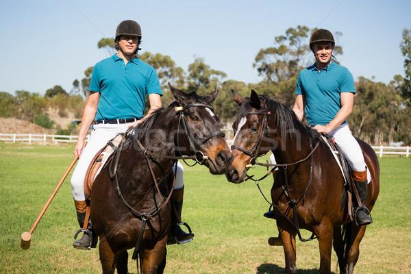 Twee mannelijke paardrijden paard boerderij Stockfoto © wavebreak_media