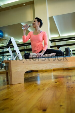 Remote control and tablet on table against girl Stock photo © wavebreak_media