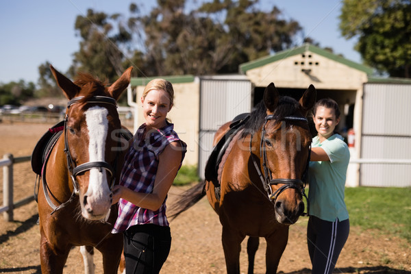 Portrait female friends with horses Stock photo © wavebreak_media