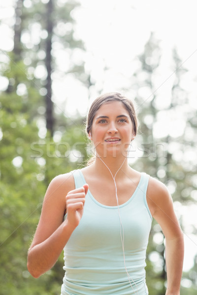 Happy jogger running and listening to music Stock photo © wavebreak_media