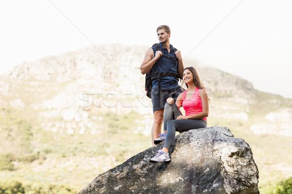 Young happy joggers standing on rock Stock photo © wavebreak_media