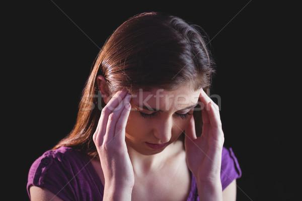 Pretty woman getting a headache Stock photo © wavebreak_media