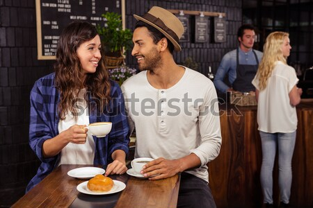 Barátok elektronikus kütyük kávé kávézó üzlet Stock fotó © wavebreak_media