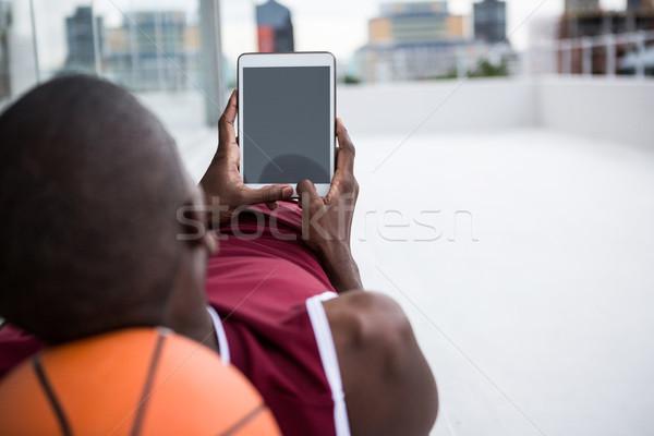 Basketball player using digital tablet Stock photo © wavebreak_media
