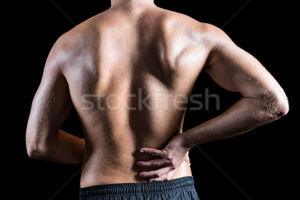 Rear view of shirtless man with back pain Stock photo © wavebreak_media