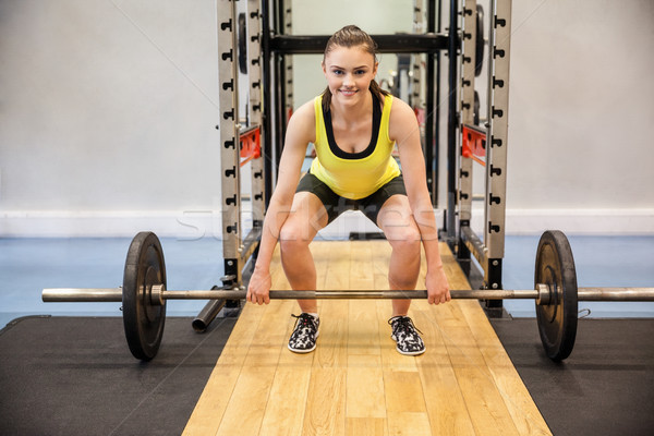концентрированный женщину лифт штанга весов спортзал Сток-фото © wavebreak_media