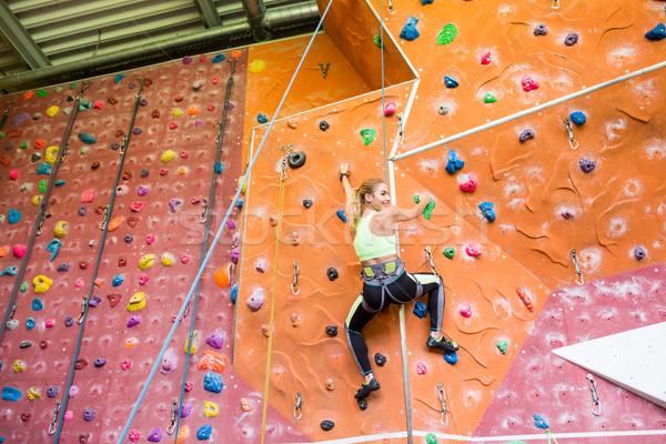 Fit blonde rock climbing indoors  Stock photo © wavebreak_media