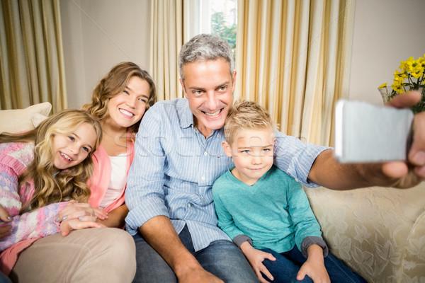Gelukkig gezin sofa woonkamer huis liefde Stockfoto © wavebreak_media