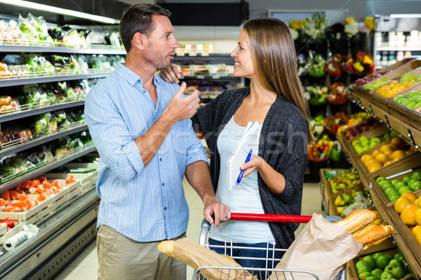Cute couple doing grocery shopping together Stock photo © wavebreak_media