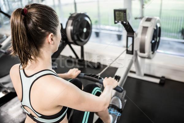 Encajar morena dibujo máquina gimnasio mujer Foto stock © wavebreak_media
