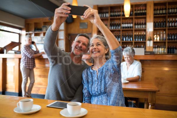 Senior couple taking selfie with mobile phone in restaurant Stock photo © wavebreak_media