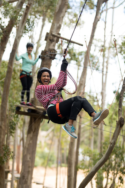 Woman on zipline in adventure park Stock photo © wavebreak_media