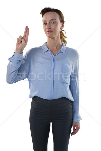 Female executive pretending to use an invisible screen Stock photo © wavebreak_media