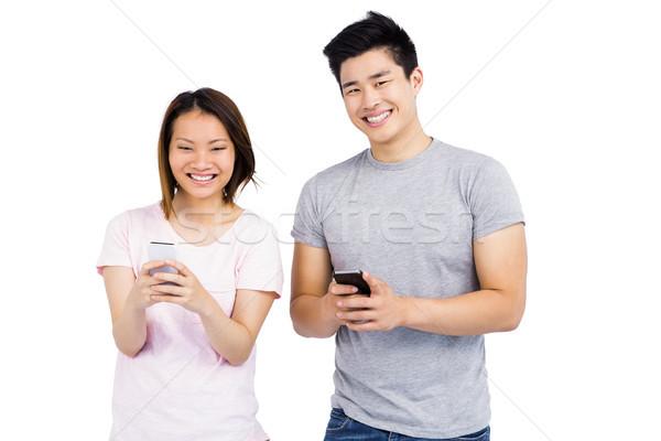 Wesoły sms telefonu komórkowego biały miłości Zdjęcia stock © wavebreak_media