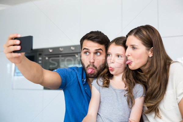 Family sticking out tongue while clicking selfie  Stock photo © wavebreak_media