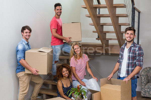Happy young friends relocating in new house Stock photo © wavebreak_media