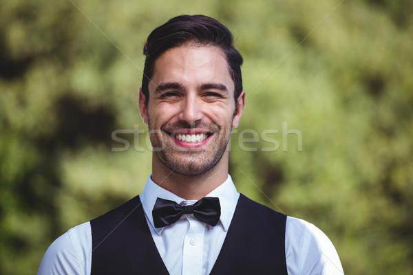 Handsome waiter smiling at camera Stock photo © wavebreak_media