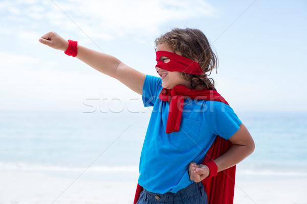 Chłopca superhero kostium latać morza brzegu Zdjęcia stock © wavebreak_media