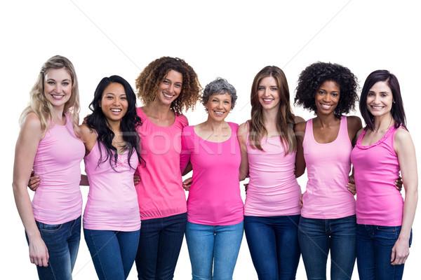 Heureux femmes permanent ensemble bras Photo stock © wavebreak_media