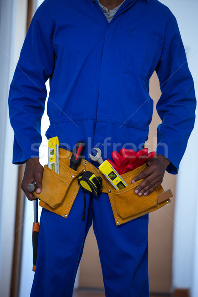 Mid section of handy man wearing tool belt Stock photo © wavebreak_media