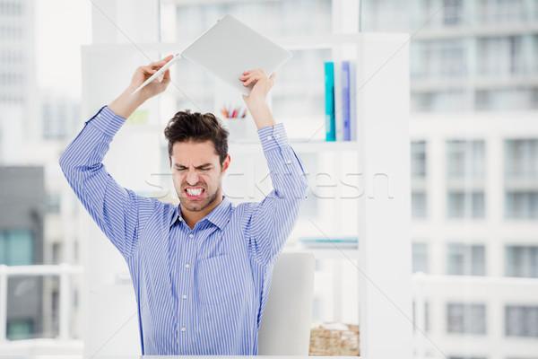 Frustrated businessman throwing laptop Stock photo © wavebreak_media